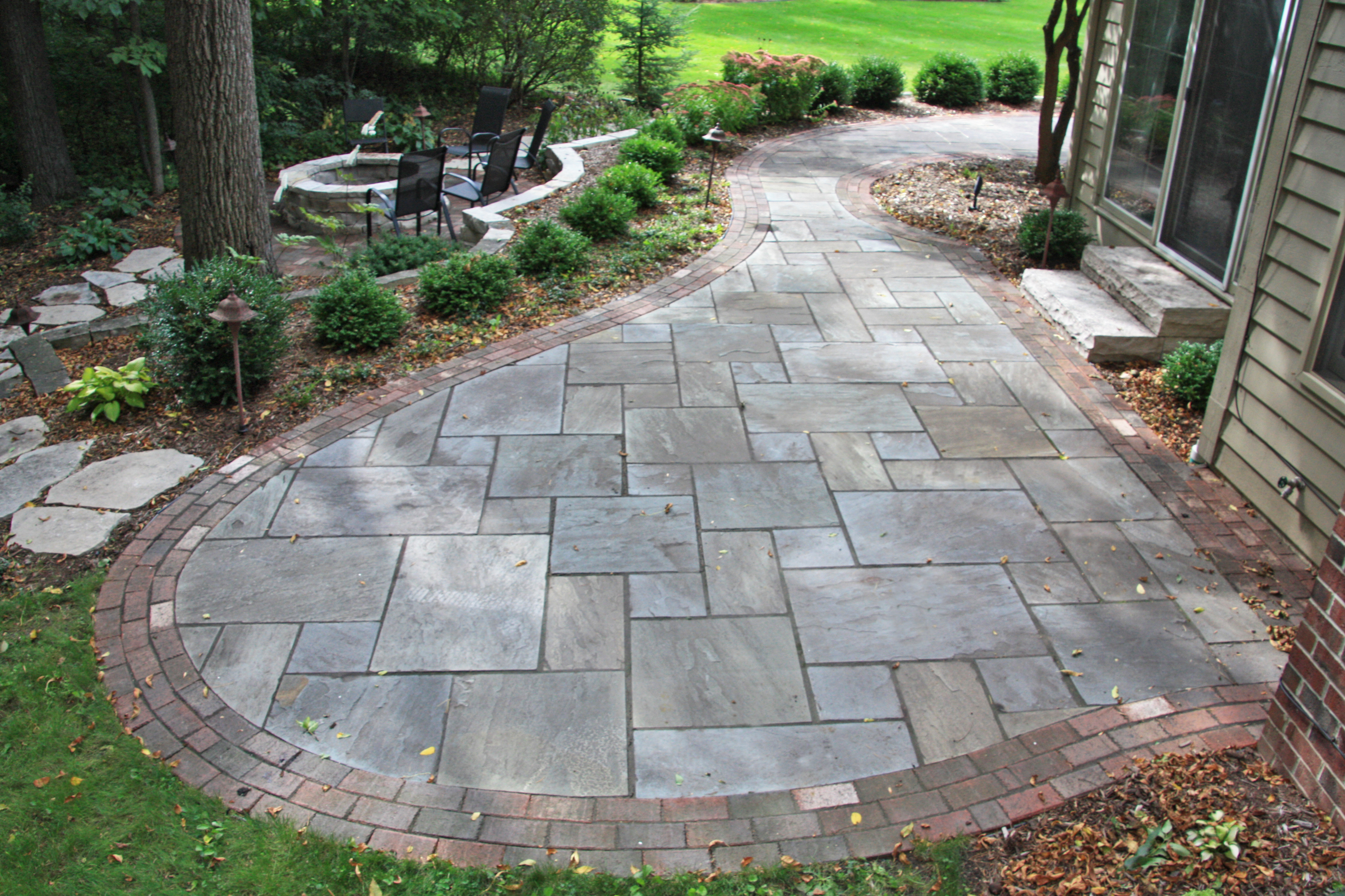 ... Side Patio. Bluestone Was Used For The New Patio And We Reused The  Bricks From The Former Patio As The Edging. A Firepit Area Was Added  Reusing The ...